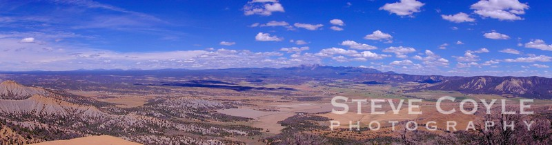 The view from the overlook at the entrance to Mesa Verde National Park. The San Juans are in the distance