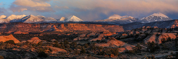 Sunset at Sand Flats Recreation Area with the snow-capped peaks of the La Sal Mountains.