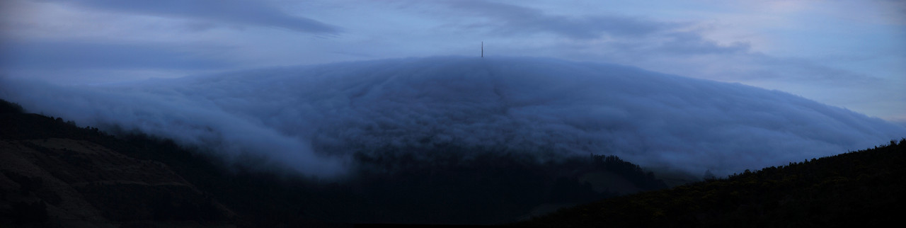 Cloud rolls over Mt Cargill in the last evening light
