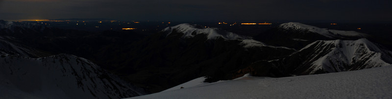 Night view from peak 2093, Mt Somers Range. The lights of Ashburton are visible between Mt Winterslow and Mt Somers. Left of Mt Winterslow is Methven, and Christchurch on the far left