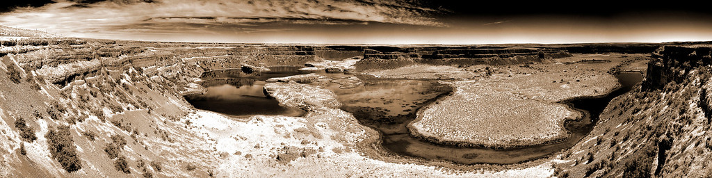 "Dry Falls - Stunning eastern Washington landscape<br /> <br /> ""Dry Falls is a 3.5 mile long scalloped precipice in central Washington, on the opposite side of the Upper Grand Coulee from the Columbia River, and at the head of the Lower Grand Coulee. Ten times the size of Niagara, Dry Falls is thought to be the greatest known waterfall that ever existed. According to the current geological model, catastrophic flooding channeled water at 65 miles per hour through the Upper Grand Coulee and over this 400-foot (120 m) rock face at the end of the last ice age. At this time, it is estimated that the flow of the falls was ten times the current of all the rivers in the world combined."" - wikipedia <a href=""http://en.wikipedia.org/wiki/Dry_Falls"">http://en.wikipedia.org/wiki/Dry_Falls</a><br /> <br /> HDR panoramic made with 8 vertical shots, 5 brackets each, Nikkor 16-35 @ f11"