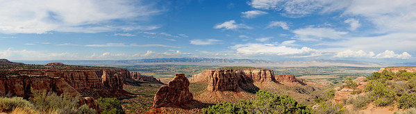 This pano is of a view in Colorado National Monument July 2007. It's a composit of 7 images, and almost 180 degrees. I have a 10x36 print hanging on my living room wall.