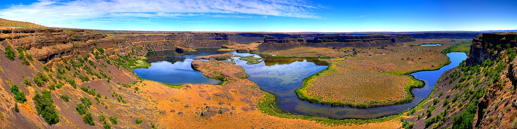 "Dry Falls - Stunning eastern Washington landscape - Color<br />  <br /> ""Dry Falls is a 3.5 mile long scalloped precipice in central Washington, on the opposite side of the Upper Grand Coulee from the Columbia River, and at the head of the Lower Grand Coulee. Ten times the size of Niagara, Dry Falls is thought to be the greatest known waterfall that ever existed. According to the current geological model, catastrophic flooding channeled water at 65 miles per hour through the Upper Grand Coulee and over this 400-foot (120 m) rock face at the end of the last ice age. At this time, it is estimated that the flow of the falls was ten times the current of all the rivers in the world combined."" - wikipedia <a href=""http://en.wikipedia.org/wiki/Dry_Falls"">http://en.wikipedia.org/wiki/Dry_Falls</a><br />  <br /> HDR panoramic made with 8 vertical shots, 5 brackets each, Nikkor 16-35 @ f11"