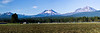 This panorama shows the Three Sisters, with Broken Top on the left side, as seen from the little town of Sisters, Oregon. The residents wake up to this view every morning.
