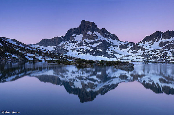 Mount Ritter and Banner Peak reflecting in Thousand Island Lake.