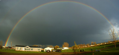 Rainbow over neibor's house