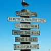 A welcome sign and live seagull herald visitor's arrival to Malibu, California