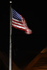 The American Flag waves in the night sky