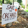 Lori Wiley and her husband Kevin have launched a mission to save the Pearl Hill Road orchard. A developer recently brought the property for $100,000. This is one of the signs at the edge of her their property across the street from the orchard. SENTINEL & ENTERPRISE/JOHN LOVE