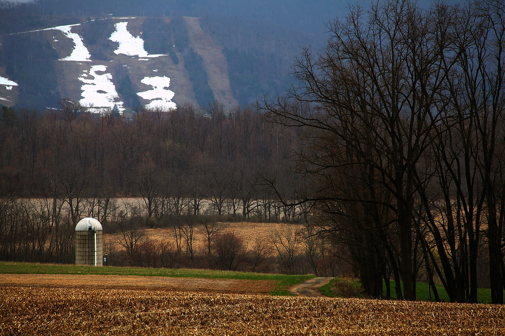 Last snow on Tussey Mtn. Ski area as seen across greening fields in Linden Hall, PA.