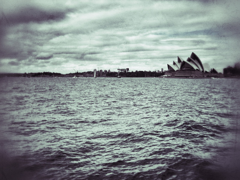 Old fashioned style long-distance shot of Sydney Opera House from ferry