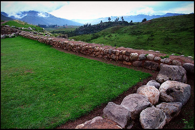 Ruins in Puca Pucara  Situated on a hill with superb views over the surrounding countryside Puca Pucara was more likely a  tambo, or kind of post house than an actual fortress. Travelers may have lodged here with their goods and animals before entering or leaving Cusco. An alternative theory is that it served as a guard post controlling the flow of people and produce between Cusco and the Sacred Valley.