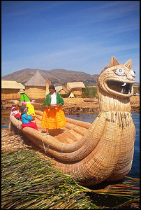 "Locals in traditional clothing and the ""totora"" boat (made of floating reeds), Uros Islands, Lake Titicaca  Uros are a pre-Incan people that live on 42 self-sustained man-made islets in Lake Titicaca, near the border of Peru and Bolivia. The Uros use the totora plant to make boats of bundled dried reeds, and to make the islands themselves."
