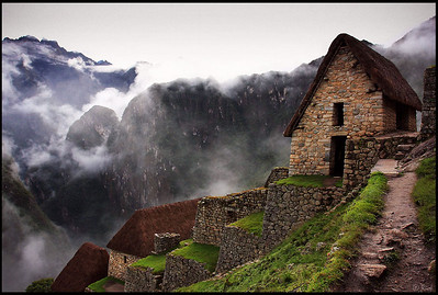 Storage Huts at Machu Picchu, Andean Mountains in Dense Morning Fog