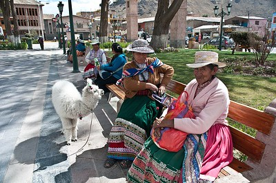 Two elderly women with bebe alpaca in Chivay, Colca, Peru