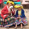 Peruvian mother and daughter with lamb in Pisac, Cusco, Peru