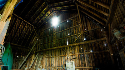 The sun blazes through a loft window in Pete's barn. Yes, that is an original Penn Yann Hand built boat on the left.