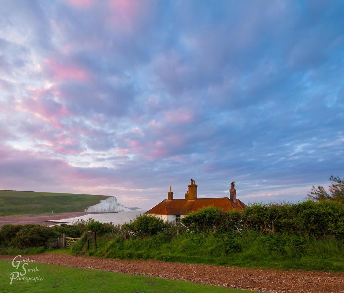 dawn at the coast guard cottages with white chalk cliffs