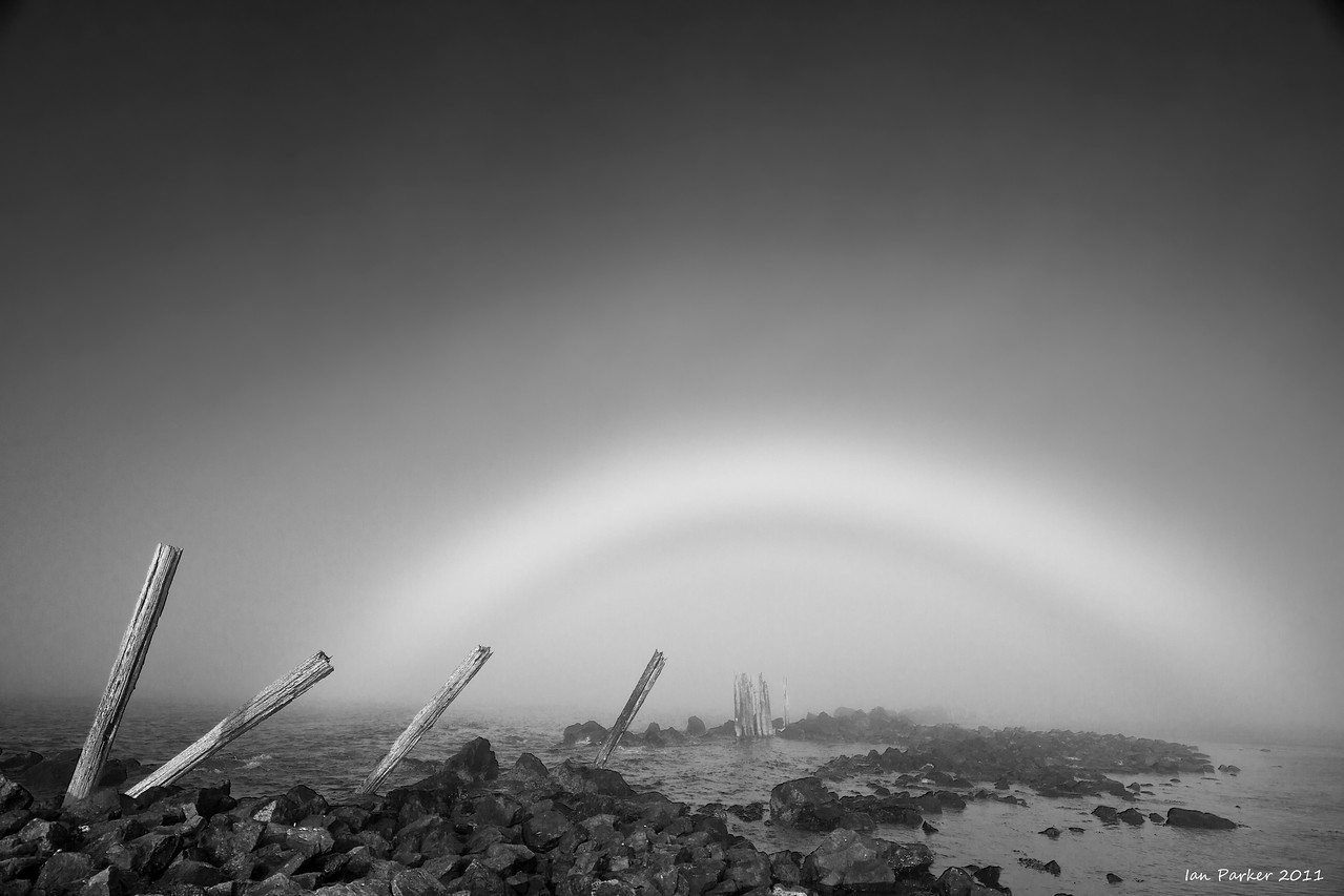 Mistbow and old pilings: Bandon Harbor, Oregon