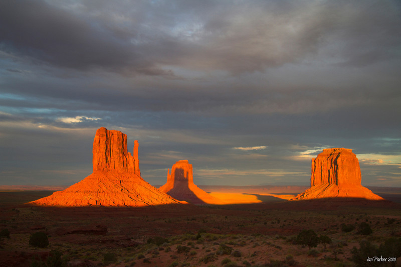 Shadow of the Mittens with overcast sky: Monument Valley, Arizona