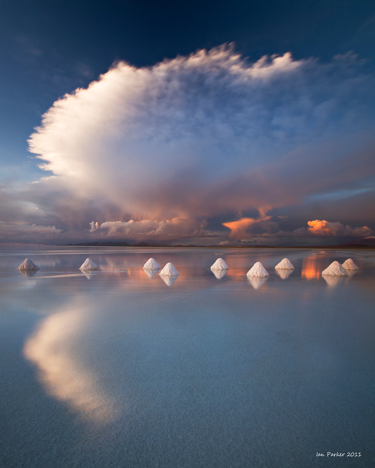 Anvil cloud and salt cones mirrored in the Salar de Uyuni: Bolivia