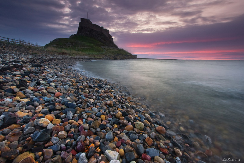 Pebble beach and Lindisfarne Castle: Holy Island, England