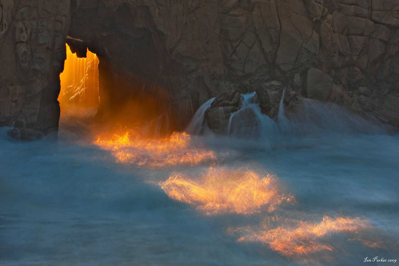Sun-rays through Pfeiffer Arch: Pfeiffer beach, Big Sur, California