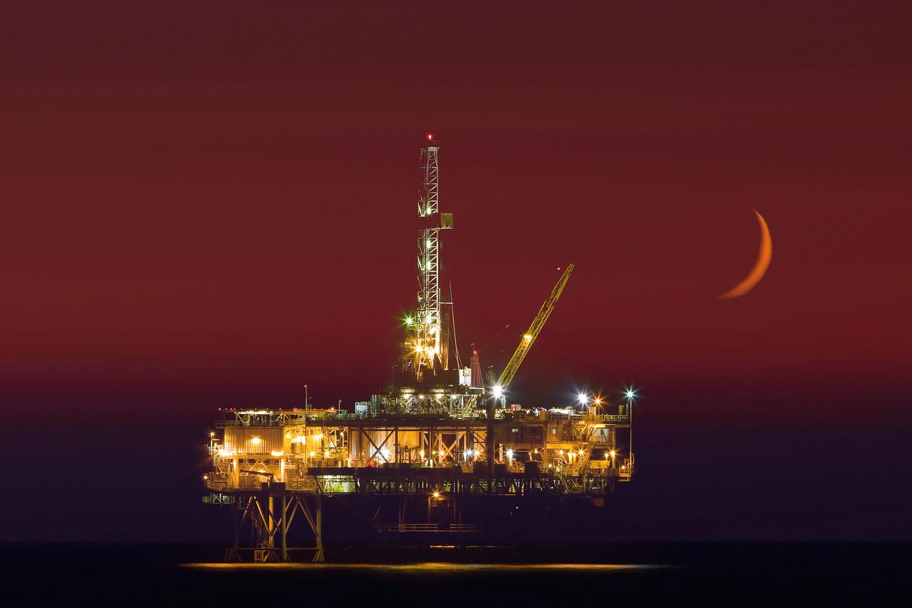 Oil rig and crescent moon: Huntington Beach, California