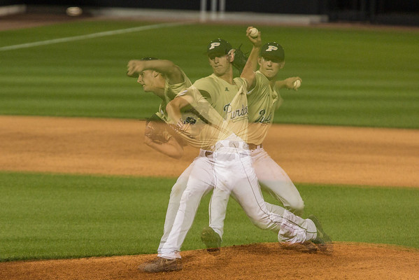 Tim McElroy pitching during the Gold and Black series