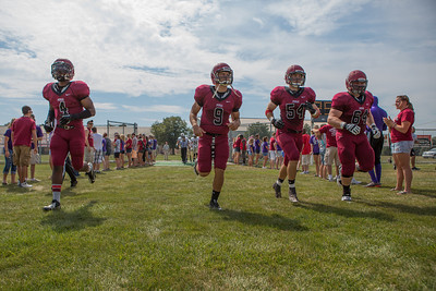 The team captains for the Pumas take the field before the college football game on September 7th, 2013 at Alumni Stadium. the St. Joseph's Puma's won 34-31 over the Valparaiso Crusaders