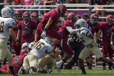 Braxton Shelton (7) leaps over the pile against Valparaiso
