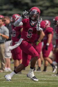 Julian Walker (5) makes a catch before the college football game on September 7th, 2013 at Alumni Stadium. the St. Joseph's Puma's won 34-31 over the Valparaiso Crusaders