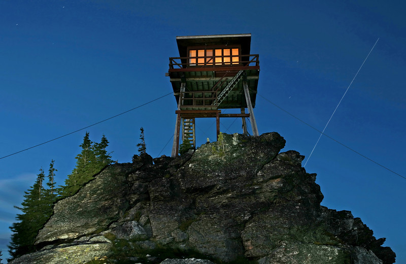 Sundance Fire Tower, Priest Lake Idaho, with space station  star trail on the right.