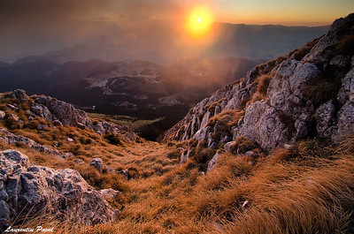 The sun is playing  Sunrise view from Piatra Craiului ridge