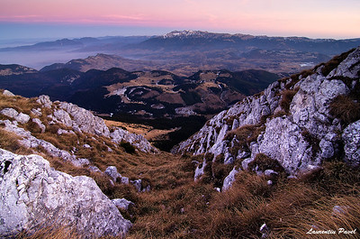 Far far away  Bucegi mountains viewed from Piatra Craiului ridge at sunset