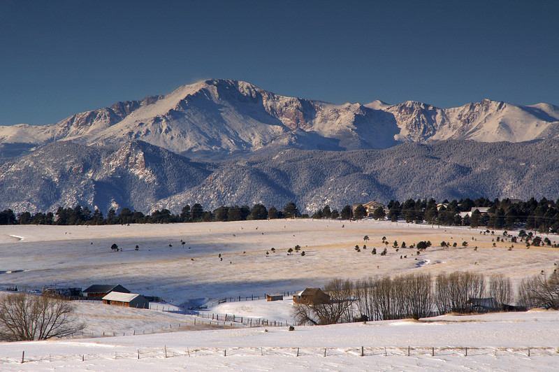 Pikes Peak snow capped from a recent spring storm can be seen from just about anywhere in Colorado Springs, Colorado.