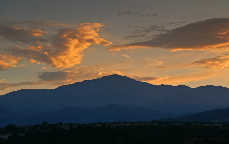 Pikes Peak stands watch as the sun sets over El Paso County, Colorado
