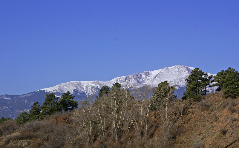A snow capped Pikes Peak on a beautiful winter morning. Pikes Peak can be seen just about any where in the city.