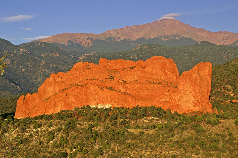 The rising sun captures two of Colorado Springs most famous icons, Kissing Camels in Garden of the Gods and majestic Pikes Peak.