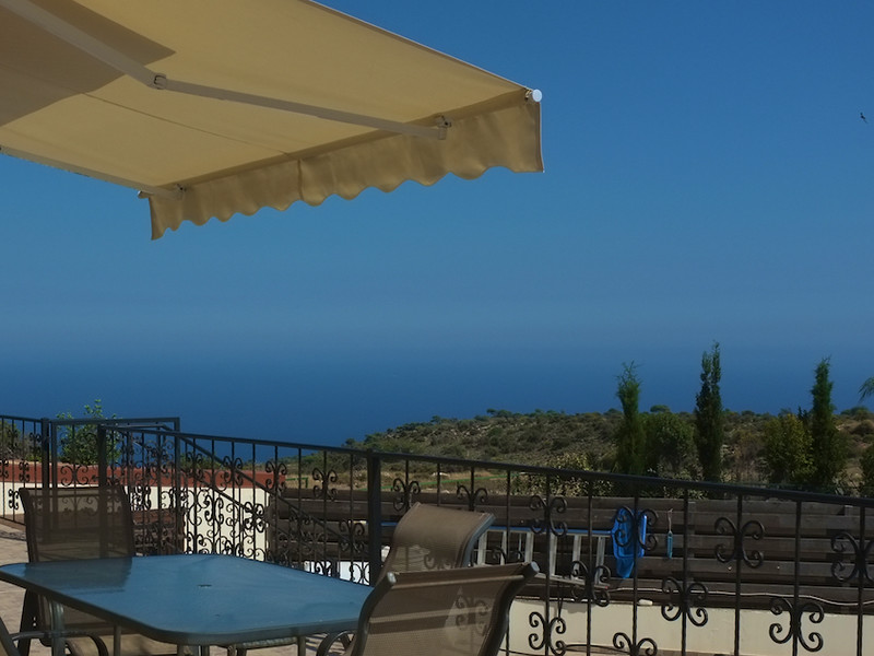 The front patio with awning and sea view
