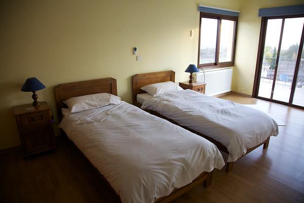 Bedroom one with patio doors
