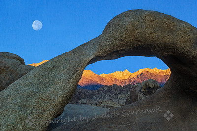 Moonset at the Arch ~ After the storms finally blew through, clear skies at dawn let the moon show through to moonset.  I had gone out to Mobius Arch (again), hoping for the dawn's light glowing from the east onto the Sierras, and for the moon to be thrown in for good measure.  Success!