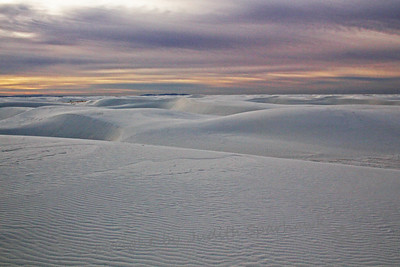 Sunrise at White Sands ~ Nice color in the sky, despite clouds covering the rising sun.  Amazing white sand dunes to explore, climb, photograph.