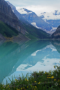 Lake Louise Reflections ~ It was a cloudy and overcast day, and I wondered out loud whether Lake Louise could possibly have its famous turquoise-blue color without a shred of blue sky overhead.  Yep, it sure did!  Early morning, the lake was glass-smooth, and the reflections were amazing.