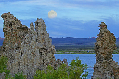 Moonrise Over Mono Lake ~ I was waiting and waiting for the full moon to rise, and suddenly saw it coming up above the clouds.  The colors were quiet blues, soon to turn to glorious oranges and pinks.