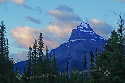Morning in Johnston Canyon ~ Around the Banff National Park, there are enormous craggy peaks everywhere you look.  This is one viewed while exploring Johnston Canyon one early morning as the sun rose.