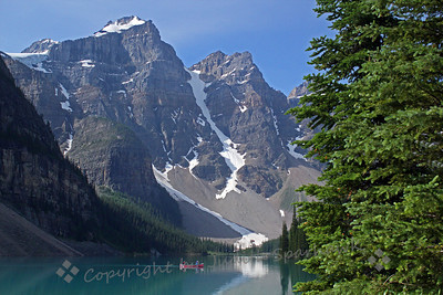 Lake Moraine ~ The lake is surrounded by craggy peaks, and has the turquoise-blue color in the water.  A hike around the lake afforded beautiful views.