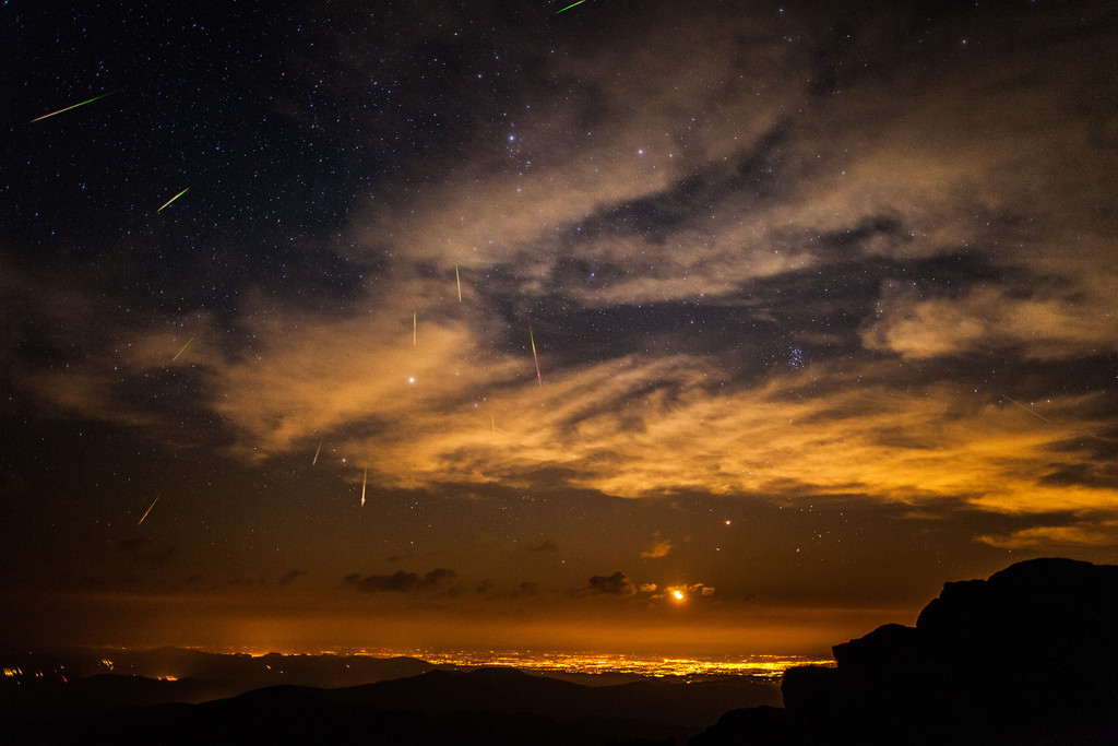 Perseid Meteors stacked exposure of the Perseid Meteors over Denver at moonrise from the summit of the 14.200' Mt Evans.
