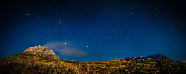 """<font size=""""5"""" font="""""""" face=""""trajan pro, Copperplate Gothic Bold""""><b>Kebler Pass</b></font> <font face=""""trajan pro"""">Moonlight covers the autumn aspen groves of Kebler pass near Crested Butte Colorado</font>"""