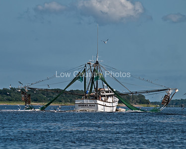 Shrimp boat with outriggers out